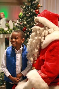 """Braydon Bailey, 5, has his picture made with Santa Claus Saturday morning during the 13th annual Breakfast with Santa entitled """"A Magical Breakfast with Santa"""" at the Vicksburg Convention Center. More than 600 people attended the annual event which was sponsored by Walmart and McDonald's, with part of the proceeds raised going to the Ronald McDonald House. (Justin Sellers/The Vicksburg Post)"""