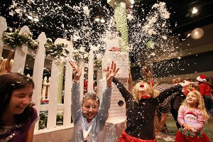 """Madison Walters, 9, from left, Abigail Mikulski, 9, Kennedy Mullins, 7, and Piper Keyes, 5, throw artificial snow into the air Saturday morning during the 13th annual Breakfast with Santa entitled """"A Magical Breakfast with Santa"""" at the Vicksburg Convention Center. More than 600 people attended the annual event which was sponsored by Walmart and McDonald's, with part of the proceeds raised going to the Ronald McDonald House. (Justin Sellers/The Vicksburg Post)"""