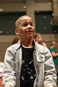 """Tyler Thomas, 5, watches as artificial snow showers down in the Vicksburg Convention Center Saturday morning during the 13th annual Breakfast with Santa entitled """"A Magical Breakfast with Santa."""" More than 600 people attended the annual event which was sponsored by Walmart and McDonald's, with part of the proceeds raised going to the Ronald McDonald House. (Justin Sellers/The Vicksburg Post)"""