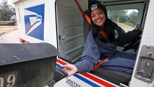 Mail carrier Charlie Harriod, who has worked with the U.S. Postal Service for about a year, delivers mail Wednesday on McAuley Drive. (Justin Sellers/The Vicksburg Post)