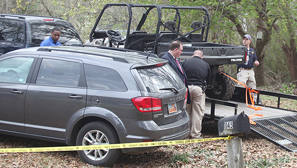 Officials with the FBI and the Mississippi Bureau of Investigation pack up their gear following Thursday's investigation on Rodney Road, where the body of Otis James Byrd, 54, was found hanging from a tree. The FBI has take over as the lead agency in the death investigation.  --- Josh Edwards | The Vicksburg Post