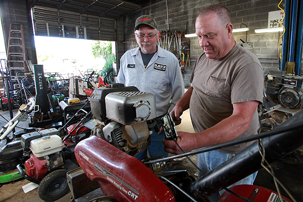 Fred Katzenmeyer, left, co-owner of Katz Brothers, 1621 Walnut St., watches Wednesday while Clyde Strong works on a tiller in the shop. (Justin Sellers/The Vicksburg Post)