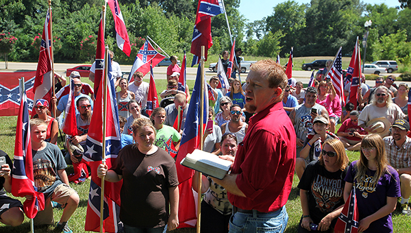 A MOMENT OF PRAYER: Andy Johnson leads a prayer Saturday during a Confederate flag rally at the Vicksburg National Military Park. (Justin Sellers/ The Vicksburg Post)