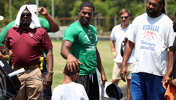 New England Patriots star and former Vicksburg standout Malcolm Butler gives a child encouraging words following the Malcolm Butler inaugural football camp at Memorial Stadium.