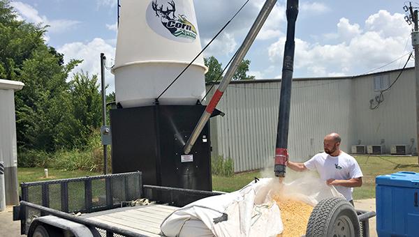 MILLION DOLLAR IDEA: Corn Xpress developer Chip Chisholm shows how the corn vending machine works at the Super Junior location on U.S. 61 North.
